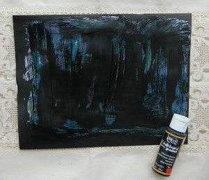 Step three art journal tutorial covering paint with petroleum with black paint